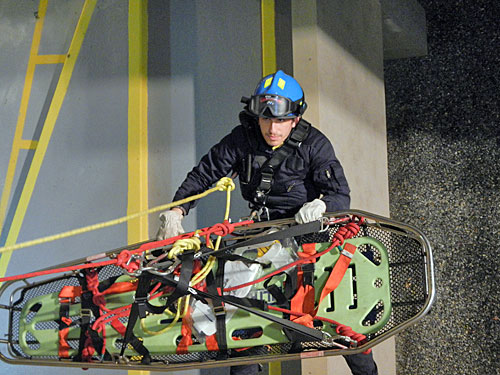 Photo caption: Hofstra North-Shore-LIJ School of Medicine medical student Michael Spigner takes part in a drill with the Manhasset-Lakeville Fire Department.